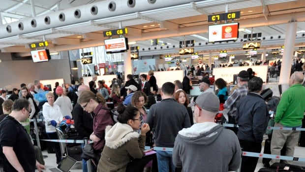 Thousands of passengers were stranded after several hundred flights at Pearson International Airport in Toronto were cancelled or delayed on Tuesday because of extreme cold weather.