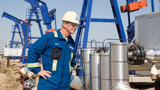A Husky Energy employee at Bolney/Celtic Oil Battery in the Lloydminster area of Saskatchewan. Husky has approved two more thermal oil projects.