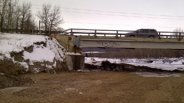 Crews are repairing the abutment on the east side of the Elbow River bridge on Highway 8.