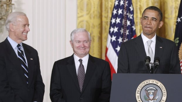 In this April 28, 2011, file photo, U.S. President Barack Obama stands in the East Room of the White House with Vice-President Joe Biden, left, and outgoing Defence Secretary Robert Gates. Gates's memoir accuses Obama of showing little enthusiasm for the U.S. war mission in Afghanistan and sharply criticizes Biden's foreign policy instincts.