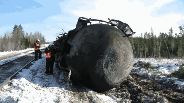 Investigators at the scene of the CN derailment in Wapske, near Plaster Rock.
