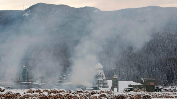 Smoke can be seen rising from the Babine Forest Products mill in Burns Lake, B.C. Saturday, Jan. 21, 2012. The explosion the day before killed two employees and injured 19 others.
