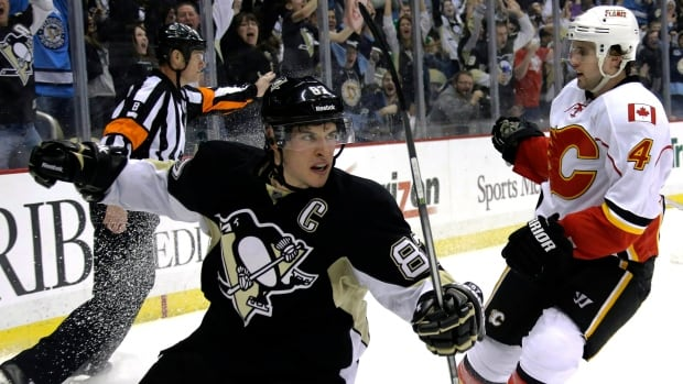 Olympics-bound Sidney Crosby and the Pittsburgh Penguins glide into Calgary Saturday night for a bout against the Flames.