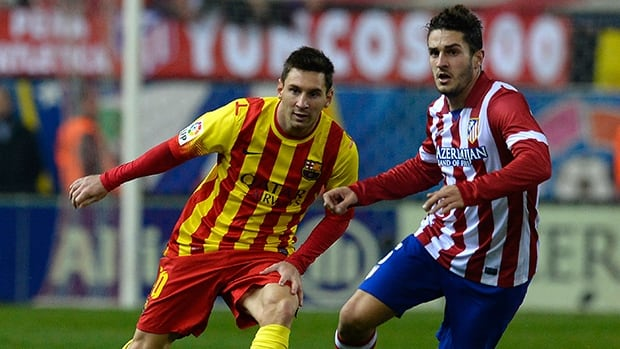 Barcelona's Lionel Messi, left, vies with Atletico Madrid's Koke during at the Vicente Calderon stadium in Madrid on January 11, 2014.