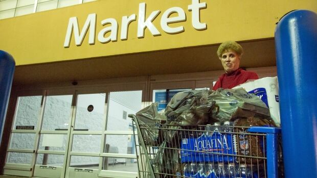 Dora Clark of Charleston, W.Va. stocks up on bottled water at a supermarket in Charleston, W.Va. on Saturday, Jan. 11, 2014 in the wake of Freedom Industries' chemical spill into the Elk River on Thursday.