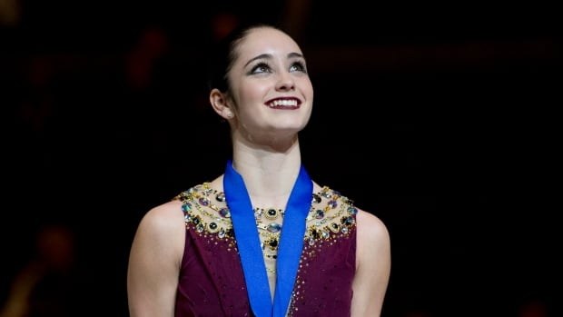 Kaetlyn Osmond smiles as she looks up during the medal ceremony at the Canadian Skating Championships, Jan. 11 in Ottawa.
