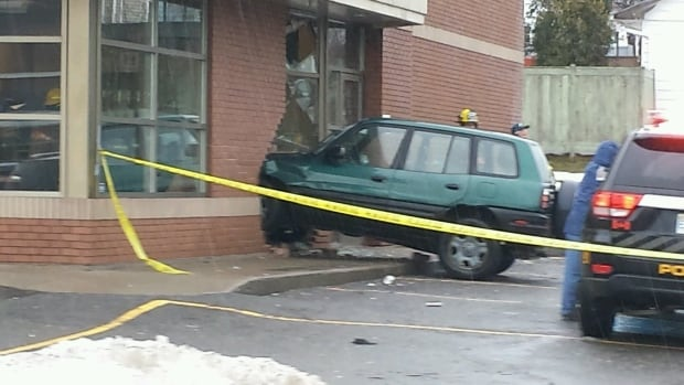 The driver smashed into the wall and broke a hole into the Tim Horton's in Whitney Pier.