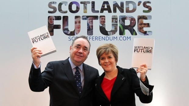 Scotland's First Minister Alex Salmond, left, and Deputy First Minister Nicola Sturgeon hold copies of a comprehensive blueprint for independence. Salmond believes Scotland is in a strong position to negotiate what its share would be of British debt.