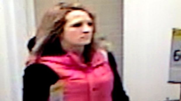 RCMP in Red Deer are seeking this woman, pictured in security camera footage, in connection to an alleged robbery at Hudson's Bay Company.