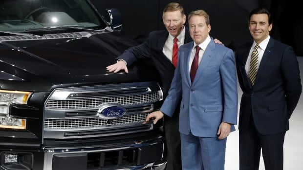 Alan Mulally, president and CEO of the Ford Motor Co., left, executive chairman Bill Ford, center, and COO Mark Fields stand next to the new Ford F-150 truck at the North American International Auto Show in Detroit, Monday, Jan. 13, 2014.