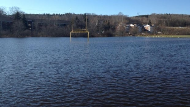 A submerged football field in Bedford. Water was half way up the goalposts.