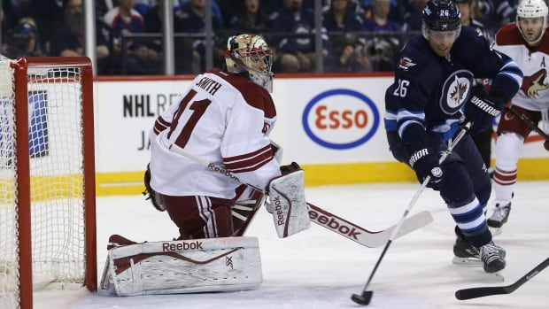 Phoenix Coyotes goalie Mike Smith watches the Winnipeg Jets' Blake Wheeler pounce on a rebound and bury it into the open net during the second period Monday at the MTS Centre.