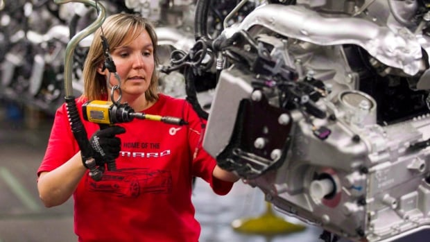 Engine Specialist Jennifer Souch assembles a Camaro engine at the GM factory in Oshawa, Ont., on June 10, 2011. Auto production in Ontario will continue to drop in the coming years unless there's a sudden decline in the Canadian dollar or autoworkers agree to wage concessions to better compete with the U.S. and Mexico, experts say.
