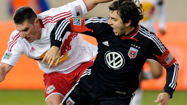 Canadian defender Dejan Jakovic, right, made 94 starts and played in 98 games with one goal in five MLS seasons for D.C. United. He's transferring to Japanese club Shumizu S-Pulse.