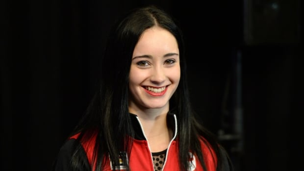 Figure skater Kaetlyn Osmond smiles during the announcement of the Canadian Olympic team in Ottawa on Sunday.