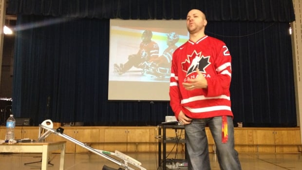 Benoit St-Amand speaks to students at Mount Pleasant Elementary in Hudson.