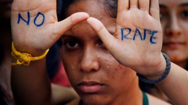 An Indian student attends a protest demanding a death sentence for the men accused of a fatal Delhi gang rape in Dec. 2013. The 23-year-old woman's death sparked protests across India.