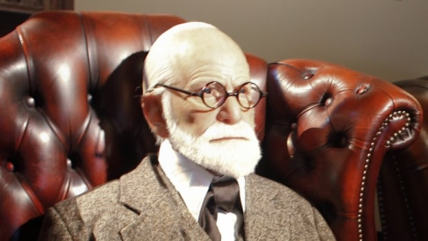London police say a 2,300-year-old Greek urn containing the remains of Sigmund Freud (shown here in a wax sculpture) and his wife Martha was severely damaged in a break-in.