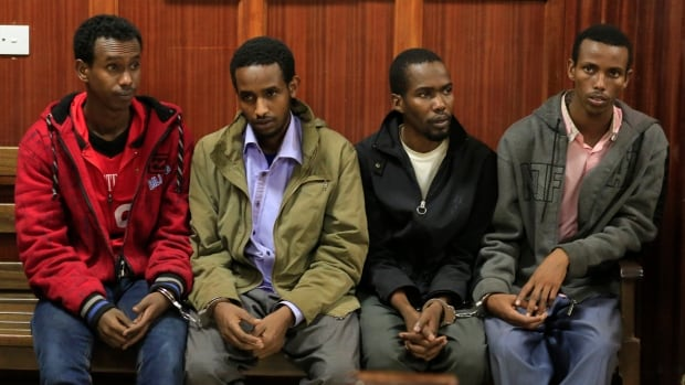 Somali men Mohamed Ahmed Abdi, Liban Abdullah Omar, Adan Mohamed Ibrahim and Hussein Hassan appear at the High Court for bail application in the Kenyan capital of Nairobi in November 2013. The four men appeared in court Wednesday for the start of their trial. REUTERS/Noor Khamis