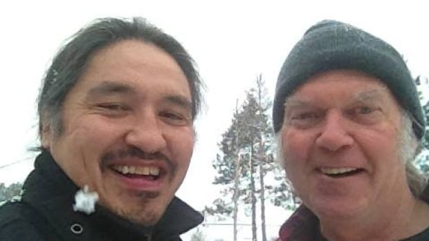 Allan Adam, chief of the Athabasca Chipewyan First Nation, poses with Neil Young. Athabasca Chipewyan Chief Allan Adam says some youth are getting restless and want to block Highway 63 — the main artery to the oilsands.