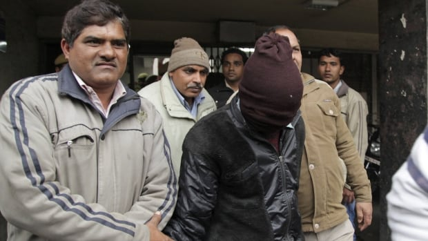 Police escort an accused man in the gang rape of a Danish tourist, 51, out of court in New Delhi, India, Thursday. The case highlights the plague of sexual violence in the country and threatens to tarnish its tourism industry.