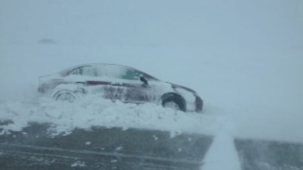 A vehicle is partially in the ditch on McGillivray Boulevard in Winnipeg on Thursday.