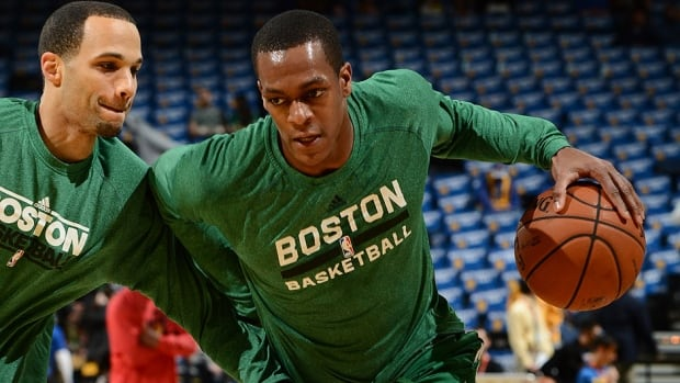 Celtics point guard Rajon Rondo, right, seen here warming up prior to a recent game, is ready to return to game action on Friday against the Los Angeles Lakers. He hasn't played since rupturing his anterior cruciate ligament on Jan. 25, 2013.
