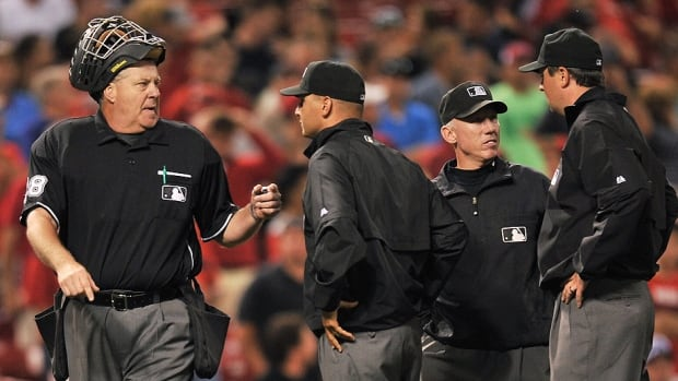 Gary Cederstrom, left, and fellow major league umpires have approved an expanded instant replay system along with team owners and players whereby close calls could be subject to video review.