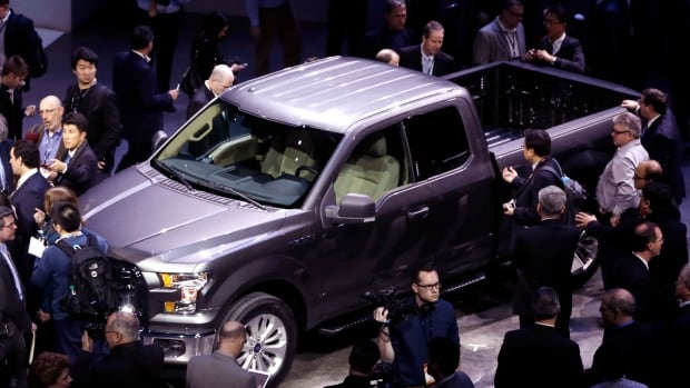 The new aluminum F-150 is 300 kg, or 700 pounds, lighter and uses 25 per cent less fuel than the current model. (Paul Sancya/The Associated Press)