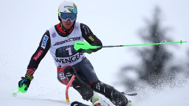 Ted Ligety clears a gate to clock the second fastest time during a slalom portion of Friday's race in Wengen.