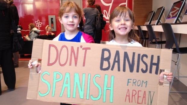 Kindergarten students Krisztina Varsanyi, left, and Taylor Krizan protest changes to their Spanish program in Calgary.