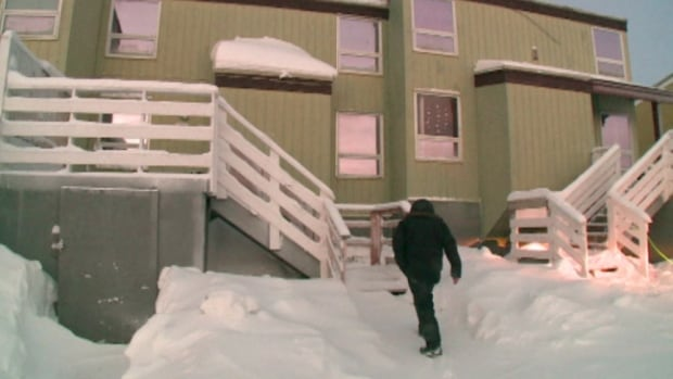 Andre Oulette heads into one of his seven townhouses in Inuvik. With fuel costs up 83 per cent from last year, Oulette he can no longer afford to maintain or repair his units.