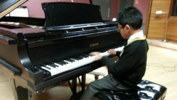9 year old Sean Buenafe studies music and composition at Yamaha School of Music.