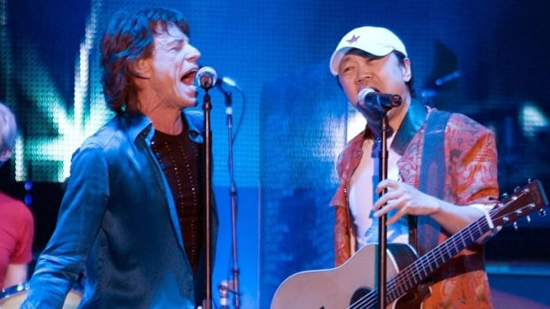 Rolling Stones lead singer Mick Jagger, left, performs with Cui Jian, China's best known rocker, at a Shanghai concert in 1989. Cui's songs were anthems for student protesters in Beijing's Tiananmen Square in 1989.