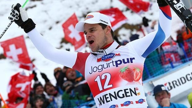 Switzerland's Patrick Kueng celebrates after winning an alpine ski, men's World Cup downhill, in Wengen, Switzerland., on Saturday. (Giovanni Auletta/Associated Press)