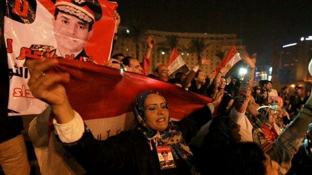 Holding national flags and portraits of military chief  Gen. Abdel-Fattah el-Sissi, Egyptians celebrate the passage of a new constitution after 98.1 per cent of voters supported Egypt's military-backed constitution in a two-day election, in Tahrir Square in Cairo on Saturday.