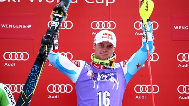 Alexis Pinturault of France., celebrates on the podium after winning a men's World Cup slalom, in Wengen, Switzerland., on Sunday. (Giovanni Auletta/Associated Press)