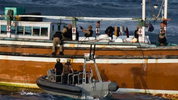 Members on the Halifax-class frigate HMCS Toronto board a suspected drug-smuggling vessel.