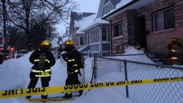 Fire crews work to extinguish a blaze at a home in the 900 block of Winnipeg Avenue on Sunday around 5 p.m.