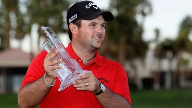 Patrick Reed poses with his trophy on the 18th green after winning the Humana Challenge on the Arnold Palmer Private Course at PGA West on Sunday in La Quinta, Calif.