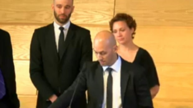 In this still from a webcast, Kory Townsend, son of killed Alberta missionary Brian Townsend, speaks at a memorial Sunday in Lacombe. Standing next to him are his brother, Robbie, and sister, Mandy Lund.