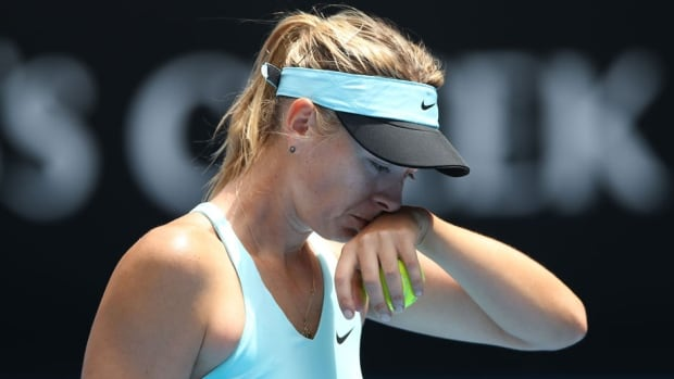 Maria Sharapova reacts to a point in her fourth-round match against Dominika Cibulkova at the Australian Open at Melbourne Park on Monday in Melbourne, Australia.