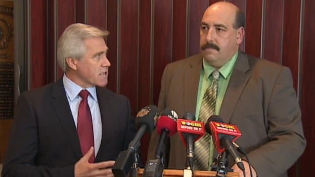Paul Lane, seen with Liberal Leader Dwight Ball at a news conference on Monday, was known for sharply defending Tory policies.