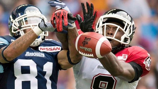 Stampeders cornerback Fred Bennett, right, has 85 tackles, five special-teams tackles, five interceptions and four forced fumbles in 36 CFL regular-season games. The team re-signed him on Monday.