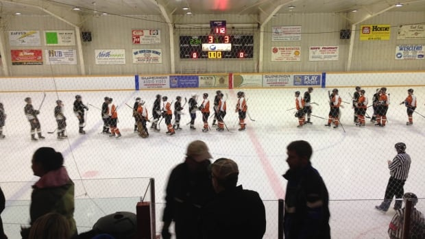 The Hay River Huskies and the Yellowknife Flyers shake hands after a tie game in Hay River Friday that went into the wee hours of Saturday morning.