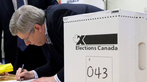 Prime Minister Stephen Harper casts his ballot in Calgary in the 2011 federal election. For 2015, the number of federal ridings will jump to 338, from 308.