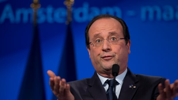 French President Francois Hollande makes a speech at the National Maritime Museum in Amsterdam, Netherlands, Monday Jan. 20, 2014.