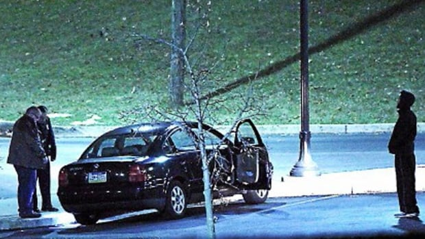 Police investigate a car at the athletic centre of Widener University in Chester, Pa. after a student was shot Monday night.