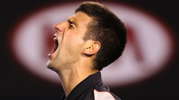 Novak Djokovic reacts to a shot during a 2-6, 6-4, 6-2, 3-6, 9-7 loss to Stanislas Wawrinka at Melbourne Park on Tuesday.