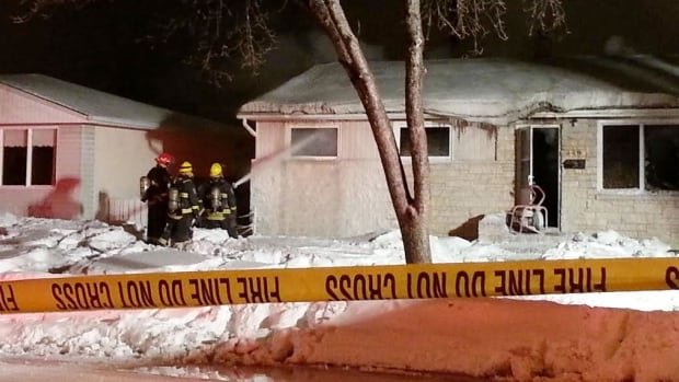 Firefighters direct their water spray into the windows of a home on Horton Avenue West on Tuesday morning.